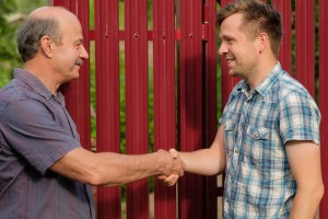Arizona home investor shakes hand with homeowner compressed
